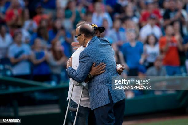 Capitol Police Special Agent David Bailey who was wounded in yesterday's shooting is hugged by former MLB player Joe Torre before throwing the first...