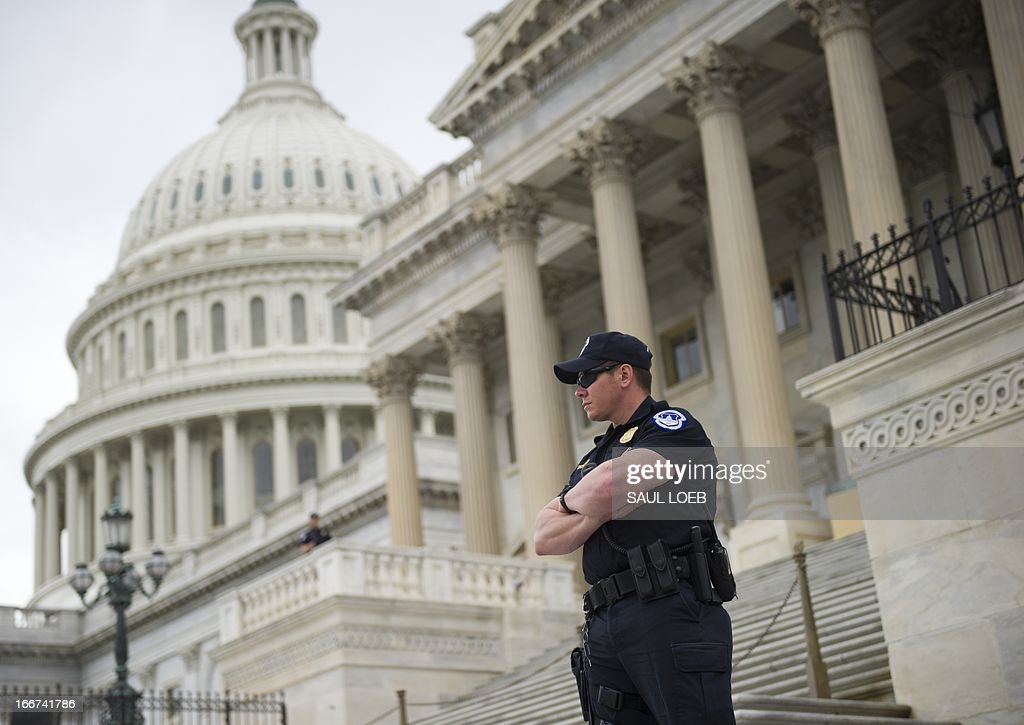 US Capitol Police stand guard outside the US Capitol in Washington on April 16, 2013 as security has been placed on a heightened alert following the bombings at the Boston Marathon. AFP PHOTO / Saul LOEB