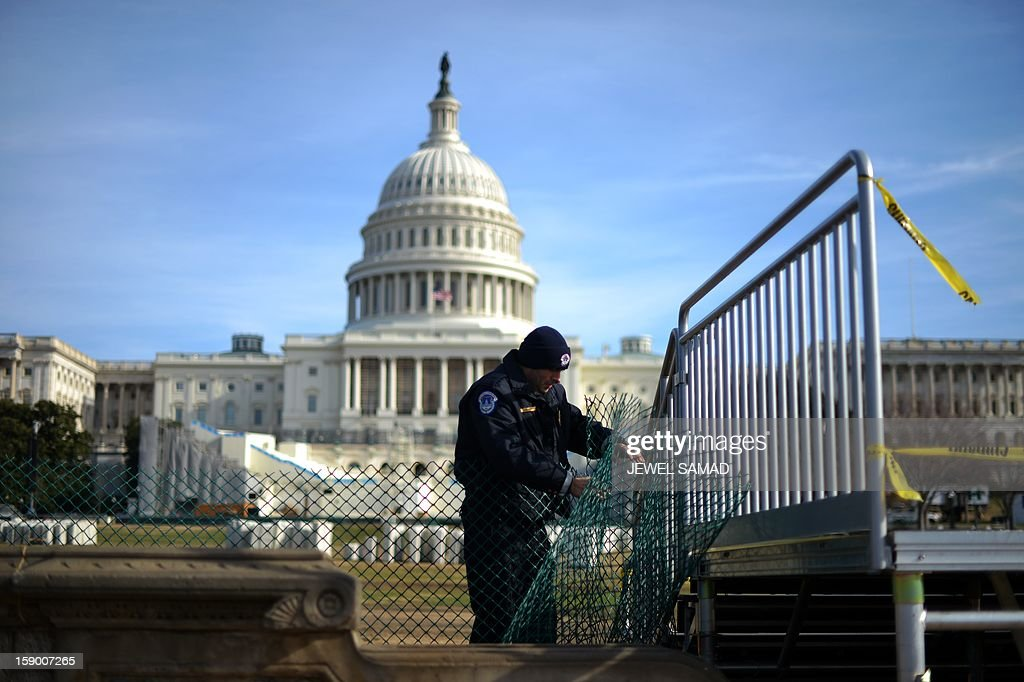 Capitol Policeman secures the area surrounding the west front of the US Capitol in Washington, DC, on January 5, 2013 as preparation are underway for US President Barack Obama's second inauguration. The public ceremony is scheduled for January 21, 2013. AFP PHOTO/Jewel Samad