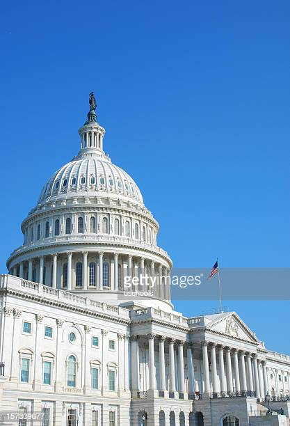 U.S. Capitol with clear sky and flag flying
