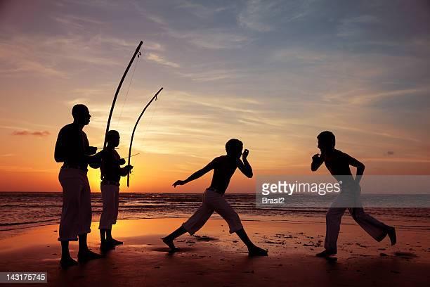 Capoeira and berimbau player
