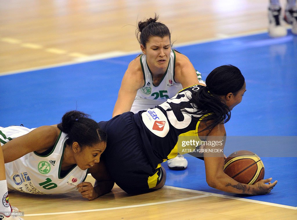 US Cappie Podexter (R) of the Turkish Fenerbahce Istanbul fights for the ball with Hungarian Anna Lakloth (C) and Spanish Cindy Lima (L) of Hungarian Hat-Agro UNI Gyor in Gyor on February 22, 2013 during their EuroLeague match. Turkish team won 77-68. AFP PHOTO / ATTILA KISBENEDEK