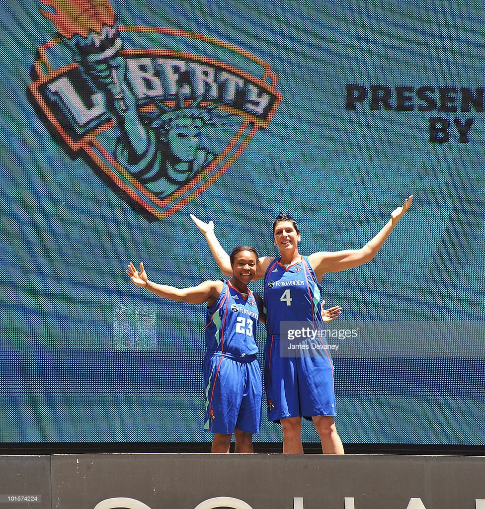 Cappie Poindexter and Janel McCarville pose for photos atop the Madison Square Garden marquee to promote new partnership between NY Liberty and Foxwoods at Madison Square Garden on June 2, 2010 in New York City.