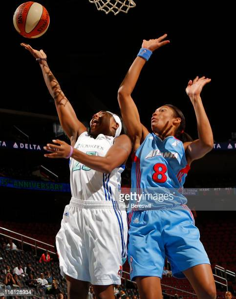 Cappie Poindexter of the New York Liberty lays up a shot against Iziane Castro Marques of the Atlanta Dream in the first half on June 14 2011 at the...