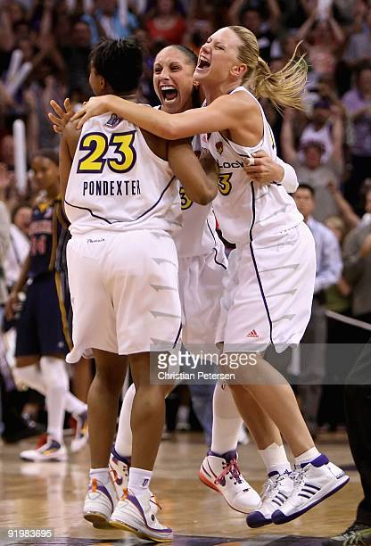 Cappie Pondexter Diana Taurasi and Penny Taylor of the Phoenix Mercury celebrate after defeating the Indiana Fever in Game Five of the 2009 WNBA...
