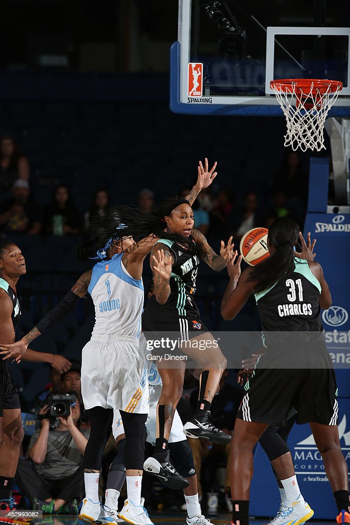 <a gi-track='captionPersonalityLinkClicked' href=/galleries/search?phrase=Cappie+Pondexter&family=editorial&specificpeople=544600 ng-click='$event.stopPropagation()'>Cappie Pondexter</a> #23 looks for a pass from teammate Tina Charles #31 of the New York Liberty NAME of the Chicago Sky during the game on July 31, 2014 at Allstate Arena in Rosemont, Illinois.