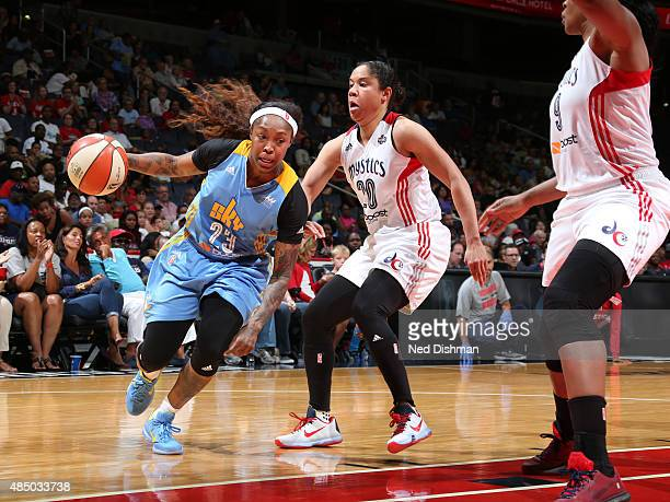 Cappie Pondexter of the Chicago Sky drives to the basket against Kara Lawson of the Washington Mystics on August 23 2015 at the Verizon Center in...