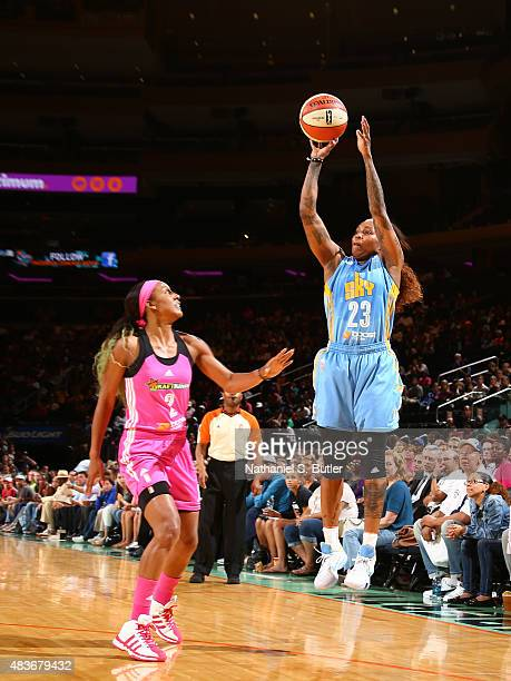 Cappie Pondexter of the Chicago Sky shoots the ball against Candice Wiggins of the New York Liberty on August 11 2015 at Madison Square Garden New...
