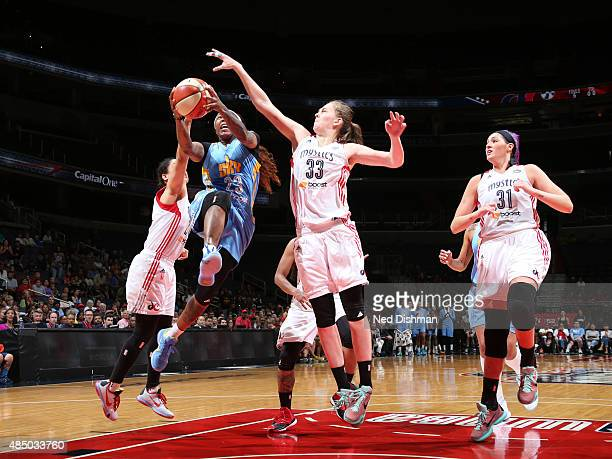 Cappie Pondexter of the Chicago Sky shoots the ball against Emma Meesseman of the Washington Mystics on August 23 2015 at the Verizon Center in...