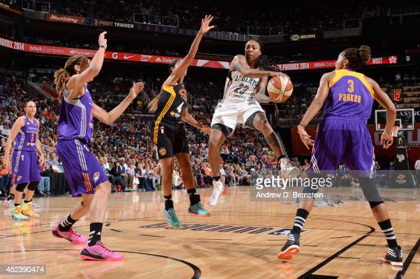Cappie Pondexter of the Eastern Conference AllStars attempts a pass against Skylar Diggins of the Western Conference AllStars during the 2014 Boost...
