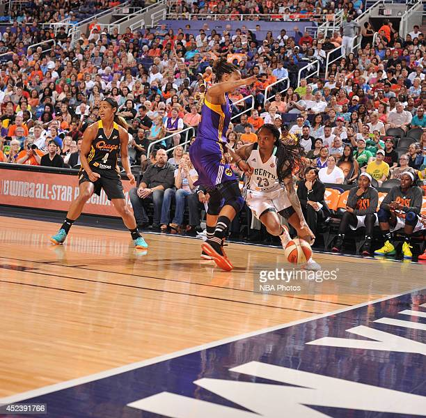 Cappie Pondexter of the Eastern Conference AllStars dribbles against Candace Parker of the Western Conference AllStars during the 2014 Boost Mobile...