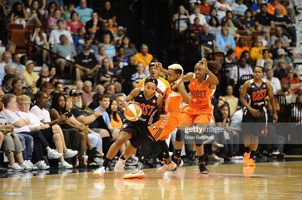 Cappie Pondexter #23 of the Eastern Conference All-Stars drives against Danielle Robinson #13 of the Western Conference All-Stars during the 2013 Boost Mobile WNBA All-Star Game on July 27, 2013 at Mohegan Sun Arena in Uncasville, Connecticut.