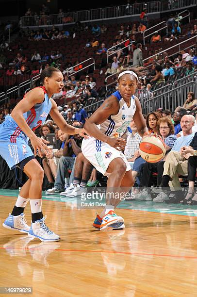 Cappie Pondexter of the New York Liberty dribbles the basketball against Armintie Price of the Atlanta Dream during the WNBA game on June 24 2012 at...