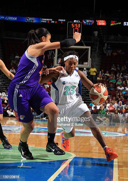Cappie Pondexter of the New York Liberty drives against Candice Dupree of the Phoenix Mercury during a game on July 30 2011 at the Prudential Center...