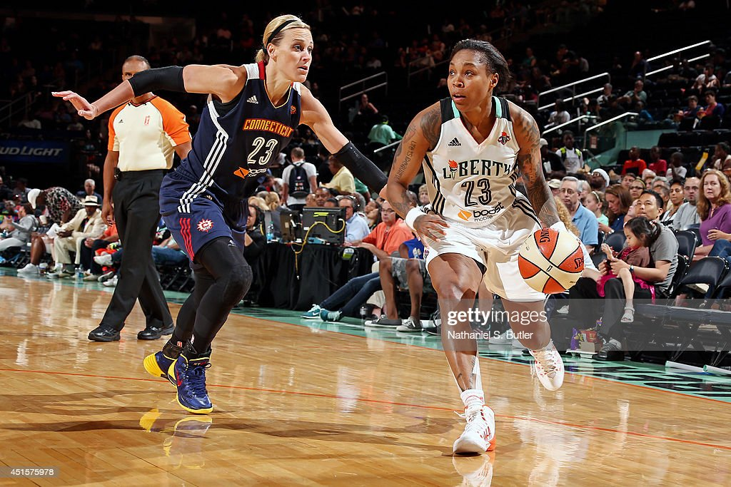 Cappie Pondexter of the New York Liberty drives against Katie Douglas of the Connecticut Sun at Madison Square Garden in New York City on June 29...