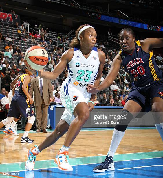 Cappie Pondexter of the New York Liberty moves the ball against Jessica Davenport of the Indiana Fever during a game on June 3 2012 at the Prudential...