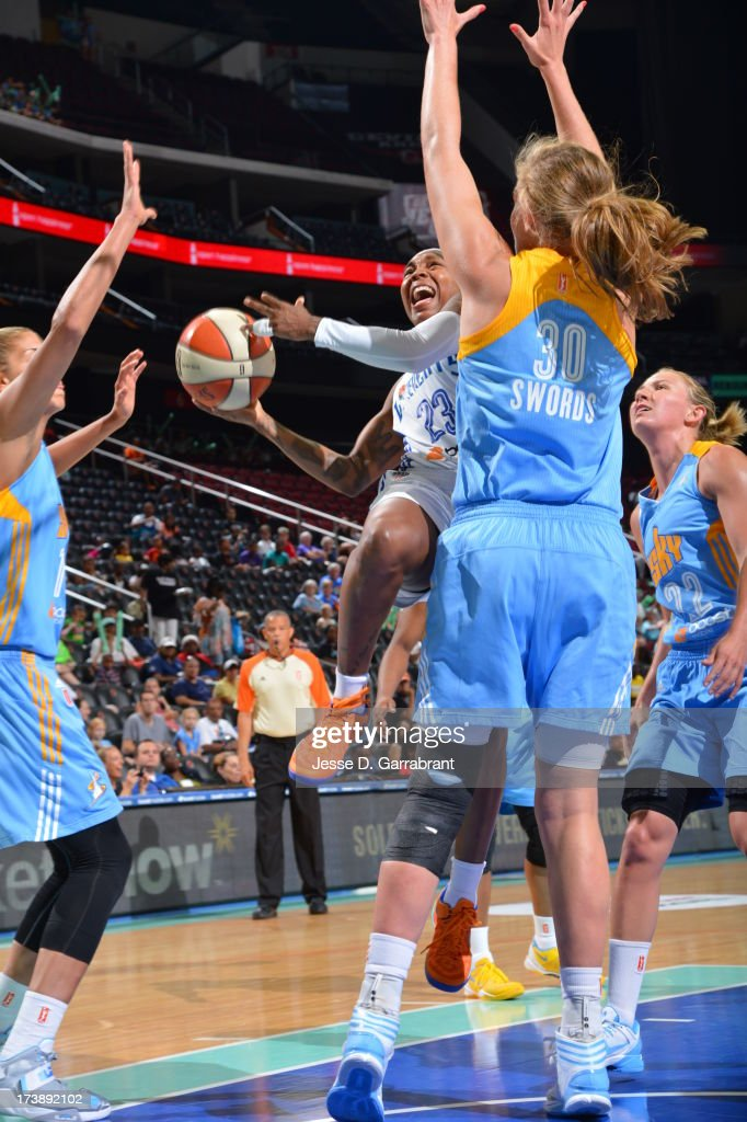 <a gi-track='captionPersonalityLinkClicked' href=/galleries/search?phrase=Cappie+Pondexter&family=editorial&specificpeople=544600 ng-click='$event.stopPropagation()'>Cappie Pondexter</a> #23 of the New York Liberty shoots against Carolyn Swords #30 of the Chicago Sky during the game on July 18, 2013 at Prudential Center in Newark, New Jersey.
