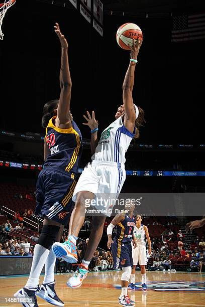 NEWARK NJ JUNE 3 Cappie Pondexter of the New York Liberty shoots against Jessica Davenport of the Indiana Fever during a game on June 3 2012 at the...