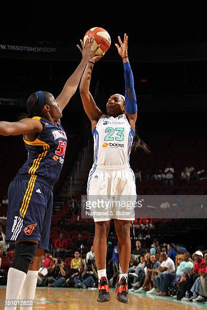 Cappie Pondexter of the New York Liberty shoots against Jessica Davenport of the Indiana Fever during a game on August 30 2012 at the Prudential...