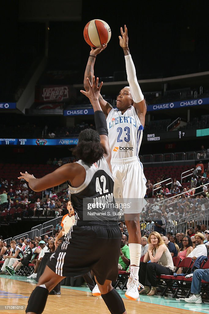 <a gi-track='captionPersonalityLinkClicked' href=/galleries/search?phrase=Cappie+Pondexter&family=editorial&specificpeople=544600 ng-click='$event.stopPropagation()'>Cappie Pondexter</a> #23 of the New York Liberty shoots against Shenise Johnson #42 of the San Antonio Silver Stars during a game on June 23, 2013 at the Prudential Center in Newark, New Jersey.