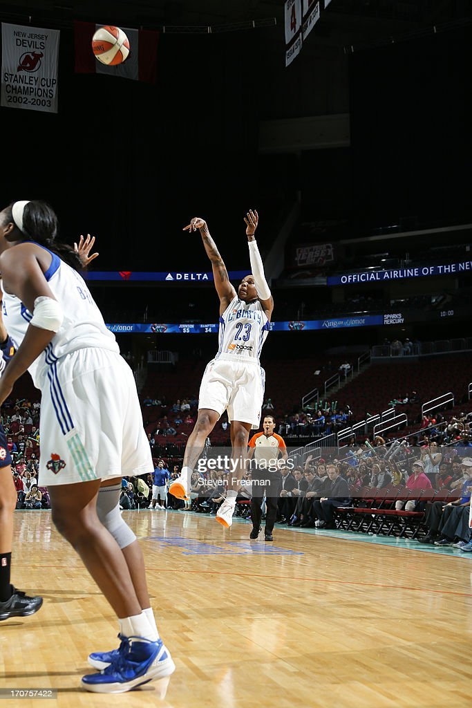 <a gi-track='captionPersonalityLinkClicked' href=/galleries/search?phrase=Cappie+Pondexter&family=editorial&specificpeople=544600 ng-click='$event.stopPropagation()'>Cappie Pondexter</a> #23 of the New York Liberty shoots during the game against the Connecticut Sun on June 14, 2013, at the Prudential Center in Newark, New Jersey NJ, June 14, 2013.