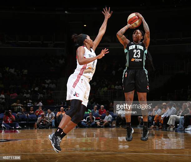 Cappie Pondexter of the New York Liberty shoots the ball against Tayler Hill of the Washington Mystics at the Verizon Center on August 16 2014 in...