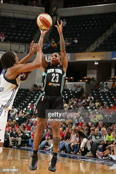 Cappie Pondexter of the New York Liberty shoots the ball against the Indiana Fever on August 14 2014 at Bankers Life Fieldhouse in Indianapolis...