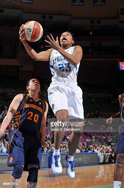 Cappie Pondexter of the New York Liberty shoots the basketball against Kara Lawson of the Connecticut Sun during the preseason WNBA game on May 11...