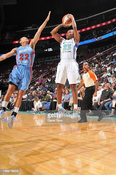 Cappie Pondexter of the New York Liberty shoots the basketball against Armintie Price of the Atlanta Dream during the WNBA game on June 24 2012 at...