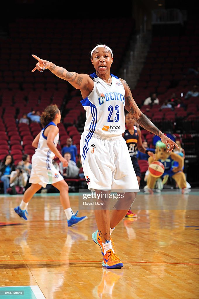 <a gi-track='captionPersonalityLinkClicked' href=/galleries/search?phrase=Cappie+Pondexter&family=editorial&specificpeople=544600 ng-click='$event.stopPropagation()'>Cappie Pondexter</a> #23 of the New York Liberty signals to here teamates during the basketball game against the Connecticut Sun on May 18, 2013 at the Prudential Center in Newark, New Jersey.