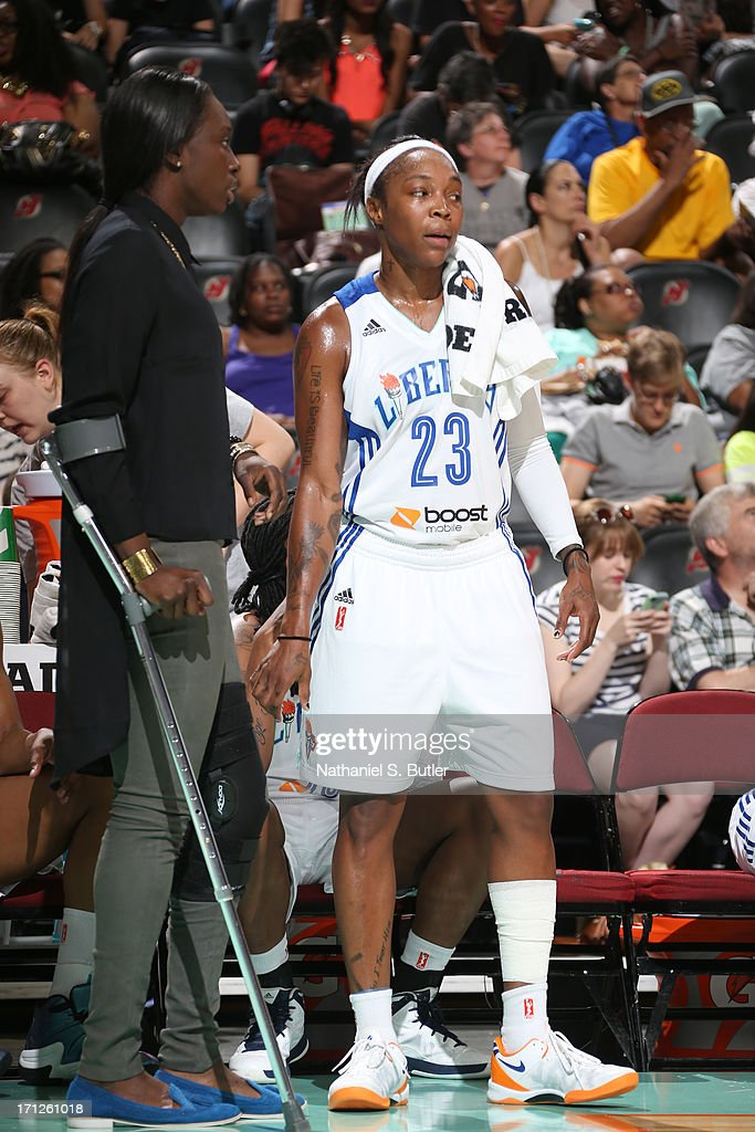 Cappie Pondexter #23 of the New York Liberty talks with teammate Essence Carson #17 of the New York Liberty at courtside during a game against the San Antonio Silver Stars on June 23, 2013 at the Prudential Center in Newark, New Jersey.