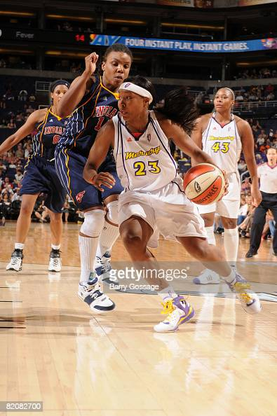 Cappie Pondexter of the Phoenix Mercury drives against Tan White of the Indiana Fever on July 27 at US Airways Center in Phoenix Arizona NOTE TO USER...