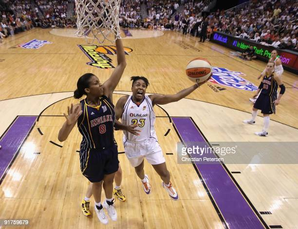 Cappie Pondexter of the Phoenix Mercury lays up a shot past Tammy SuttonBrown of the Indiana Fever in Game Five of the 2009 WNBA Finals at US Airways...