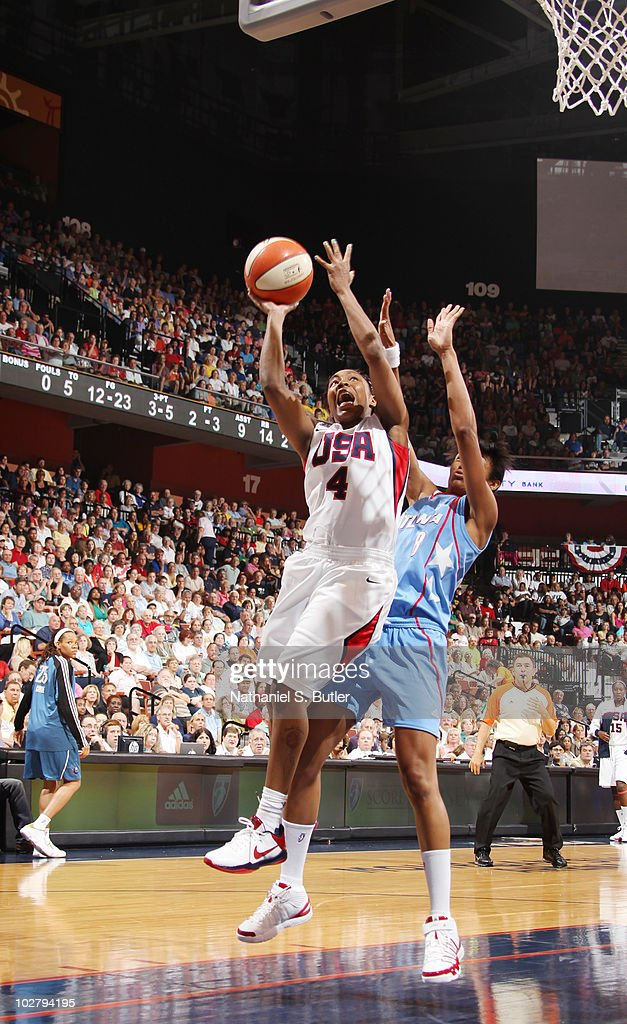 <a gi-track='captionPersonalityLinkClicked' href=/galleries/search?phrase=Cappie+Pondexter&family=editorial&specificpeople=544600 ng-click='$event.stopPropagation()'>Cappie Pondexter</a> #4 of the USA Basketball Team shoots against Iziane Castro Marques #8 of the WNBA during the Stars at the Sun exhibition game on July 10, 2010 at Mohegan Sun Arena in Uncasville, Connecticut.