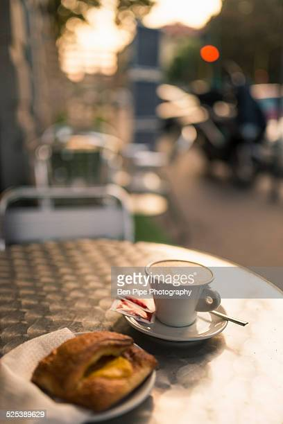 Cappuccino at sidewalk cafe, Milan, Lombardy, Italy