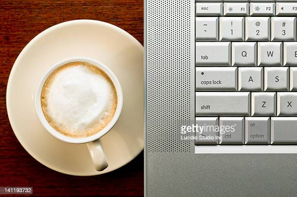 Cappuccino coffee and laptop computer