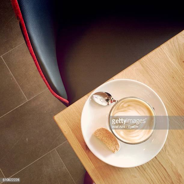 Cappuccino coffee cup with leaf design