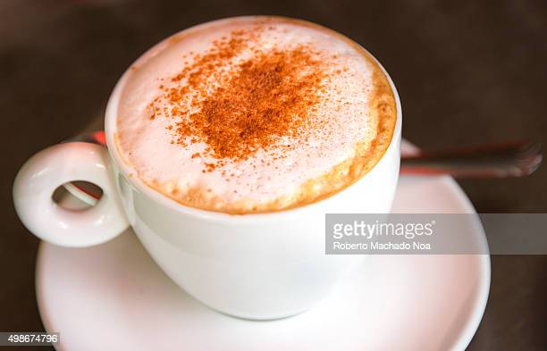 Cappuccino coffee with chocolate sprinkled on top at a restaurant in Toronto Canada Cappuccino is an Italian coffee drink which is traditionally...