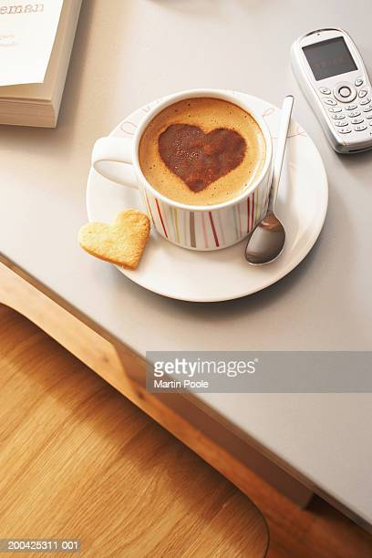 Cappuccino decorated with heart shaped chocolate motif