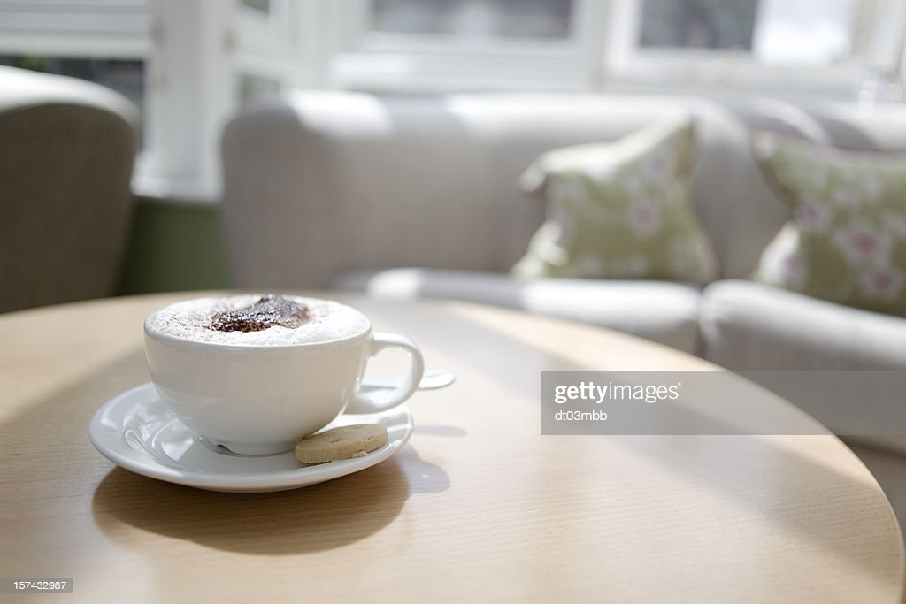 Cappuccino in a cup on a coffee table