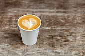 Cappuccino in a paper cup to go