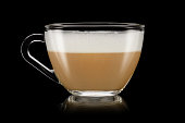 A cup of cappuccino on the black background