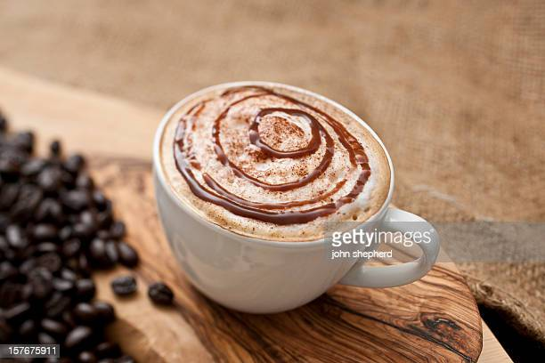 Cappuccino topped with swirls of chocolate sauce