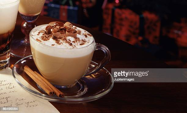 Cappuccino with chocolate and cinnamon sticks
