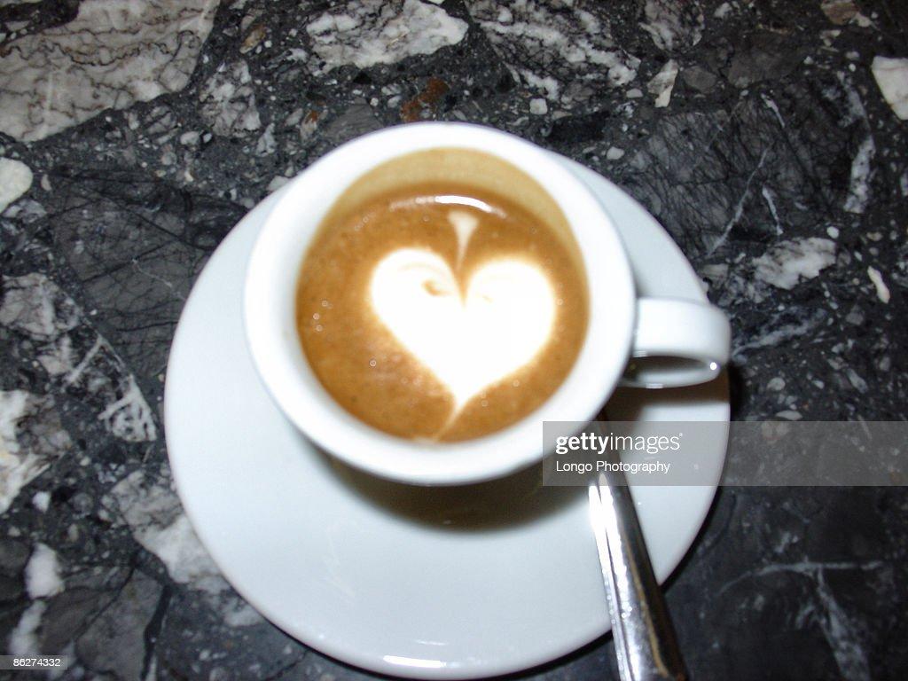cappuccino with white heart foam : Stock Photo