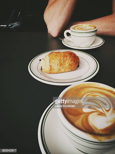 Cappucinos and a pain au chocolate