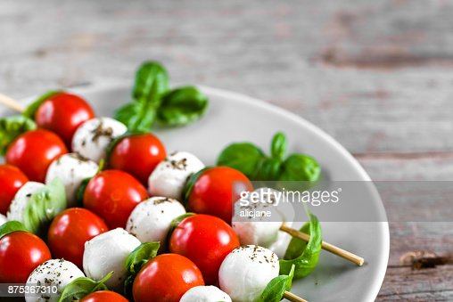 Caprese salad - skewer with tomato, mozzarella and basil, italian food and healthy vegetarian diet concept : Stock Photo