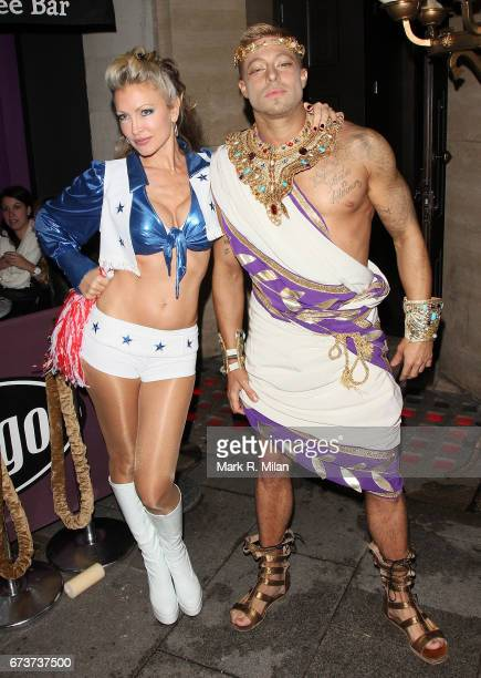 Caprice Bourret and Duncan James depart her 40th birthday and Halloween party at the Cuckoo Club on October 27 2011 in London England
