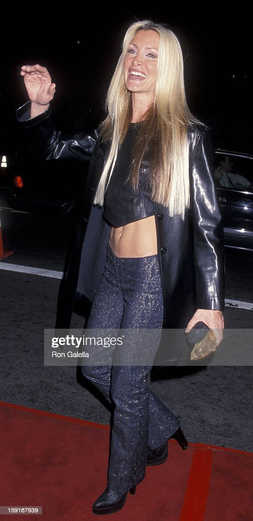 Caprice Bourret attends the world premiere of 'The Sixth Day' on November 13 2000 at Mann National Theater in Westwood California