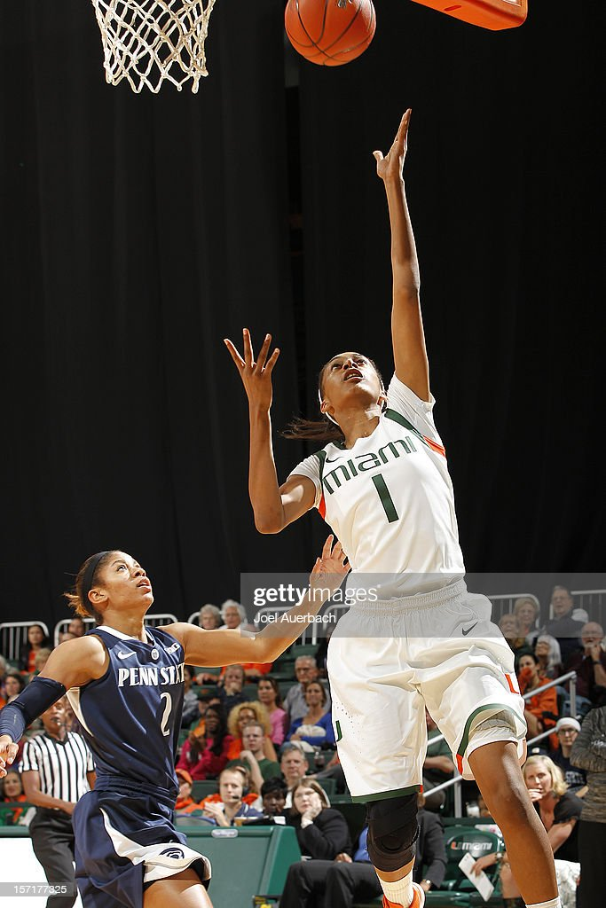 Caprice Dennis #1 of the Miami Hurricanes scores past Dara Taylor #2 of the Penn State Lady Lions on November 29, 2012 at the BankUnited Center in Coral Gables, Florida. Miami defeated Penn State 69-65.